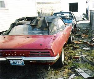 69 Firebird convertible damaged by bricks from chimney falling and roof shingles that came from house fire caused by Pawtucket mill fire.